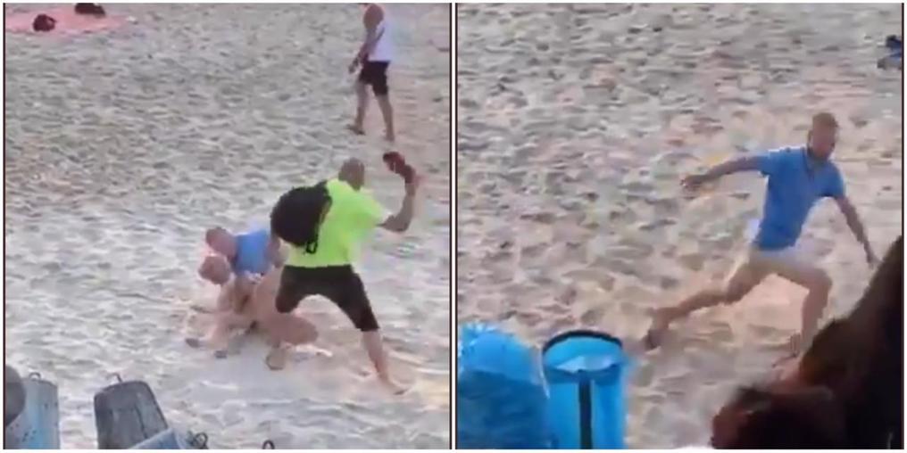 Casal leva chineladas durante momento íntimo em praia movimentada (Imagem: Reprodução vídeo The Sun)